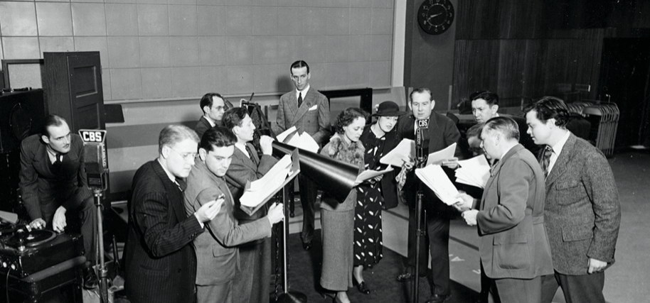 Radio cast rehearsing